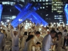 Diners participating in the Diner en Blanc light sparklers at the Jack Poole plaza, Vancouver